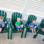 four kids eating ice cream in adirondack chairs